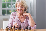 Mature woman playing chess