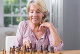 Mature woman playing chess