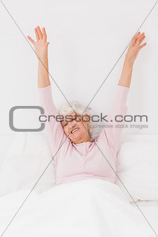 Woman yawning and stretching