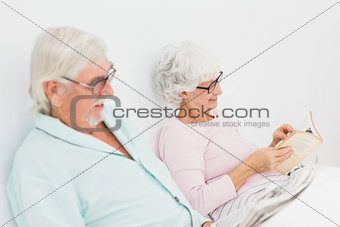 Husband and wife reading in bed