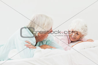 Couple chatting in bed