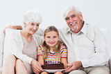 Little girl celebrating birthday with grandparents