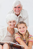 Little girl smiling with grandparents