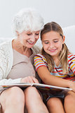 Little girl reading with granny