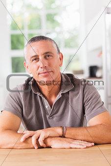 Man smiling in kitchen