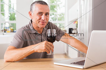 Happy man at kitchen table