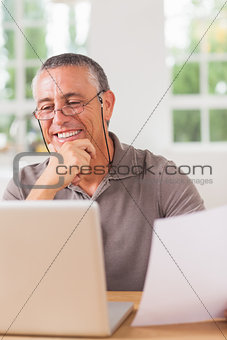Happy man working at laptop