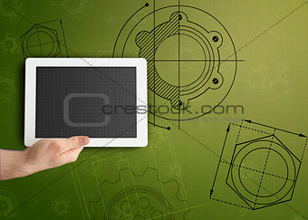 Tablet on green background