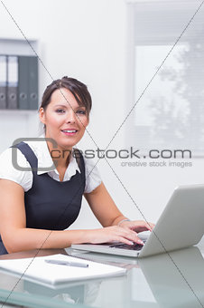 Woman working on her computer with smile