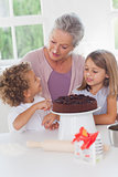 Children making cake with granny