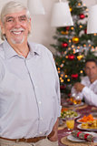 Happy grandfather standing at christmas
