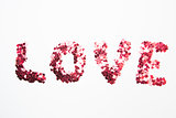 Pink confetti spelling out love
