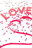 Love and heart shaped ribbon with pink confetti