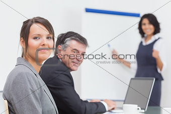 Smiling business people sitting at a table