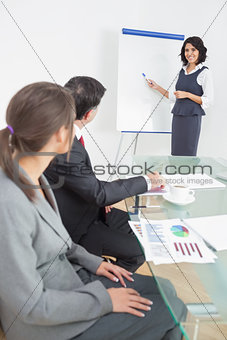 Business people listening to their manager carefully