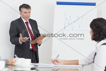 Businessman explaining to his colleague