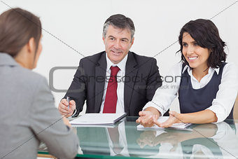 Business people talking in a small meeting
