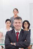 Portrait of businessman with team