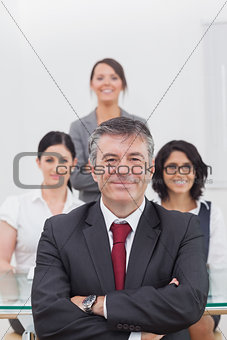 Portrait of businessman with team