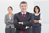 Businessman and his team smiling standing