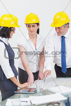 Archtects looking at construction plan