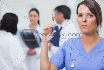 Nurse holding syringe