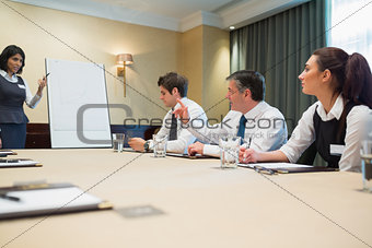 Businessman asking question at presentation