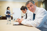 Smiling businessman during meeting