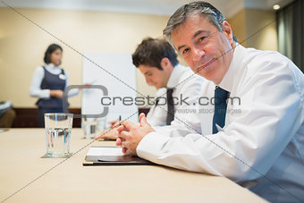 Smiling businessman during meeting