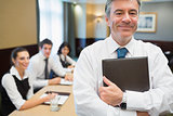 Businessman holding folder at conference