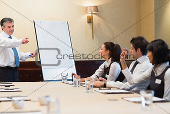 Businessman answering question during presentation