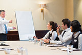 Woman asking question during business presentation