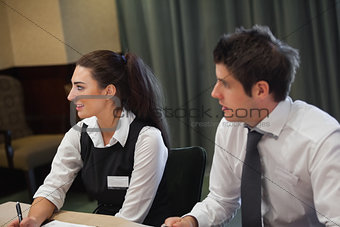 Smiling business people at meeting