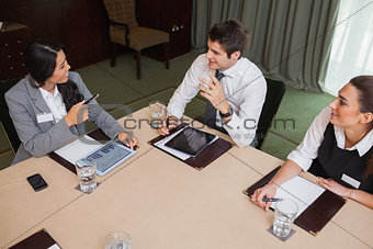 Business people talking at meeting