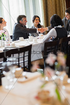 Business people having working lunch