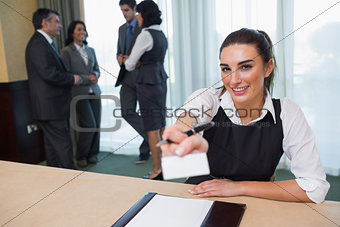 Happy woman handing you a name tag