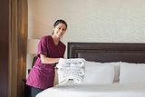 Happy maid working in hotel room