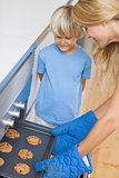 Mother and her son baking cookies