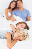Sleeping children lying on the bed