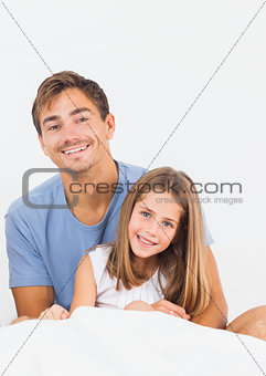 Father and daughter on the bed