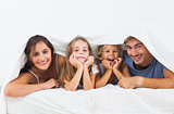 Family in the duvet smiling