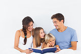 Family sitting with a book
