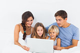 Family sitting with a laptop