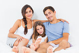 Cheerful family sitting