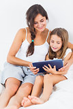 Mother and her daughter using a tablet