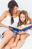 Mother and her daughter looking at a photo album
