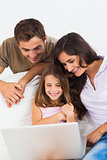 Lovely family using the laptop