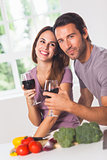 Smiling couple with wine and vegetables