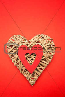 Wicker heart ornament with red cut out