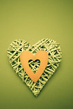 Wicker heart ornament with green paper cut out
